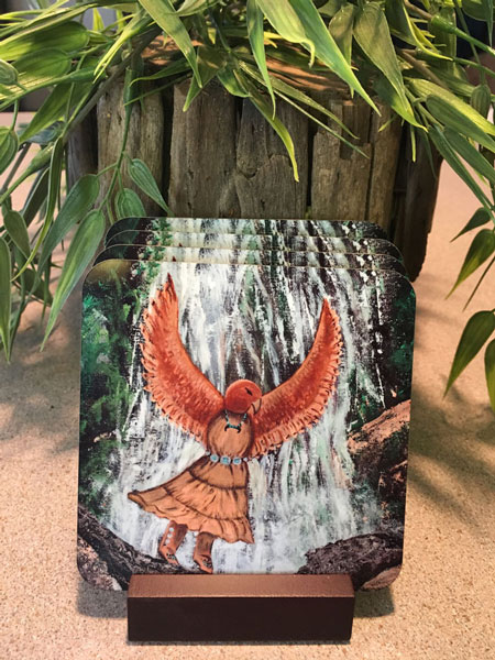 Set of four Hawk Woman coasters in wooden stand