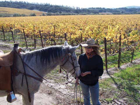Sue Roya and Lacey in the vineyard
